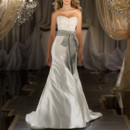 430 Slim-line designer wedding dress has Swarovski Crystal encrusted bodice to the natural waist, and covered buttons all the way down the chapel train. Grosgrain ribbon sash sold separately.