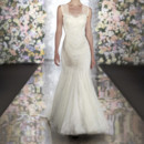 502 Soft lace and tulle fit-and-flare designer wedding gown features lovely lace shoulder straps. Back details include double diamond opening and covered buttons. Skirt flares just below the waist for figure-flattering appeal.