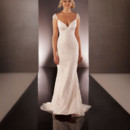 Style 606  Lace over Lustre Satin sheath bridal gown from the Martina Liana wedding gown collection features chic cap sleeves, a low V-front and back, and Diamante crystal embellishments throughout. The elegant skirt of this gown flows into a sweep train, and the back zips up under crystal buttons.