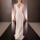 Style 628  Sheath Lace over Lustre Satin designer bridal gown from the Martina Liana wedding gown collection features a low V-neck, cap sleeves, sweep train, and a scalloped Lace keyhole back. You can choose to add hand-sewn Diamante beading throughout. The back zips up under crystal buttons.