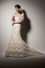 313 Rich Alencon lace A-line wedding gown with Parisian silk chiffon ruffle frill accents with vintage style beading. Lace up or zipper back available.