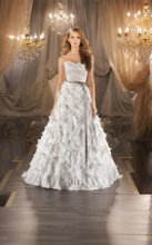 377 A-line designer wedding gown in Parisian Silk Chiffon features encrusted Swarovski crystals, diamantes and freshwater pearls on the scalloped sweetheart bodice to the natural waist and a dramatic textural skirt. Valencia satin ribbon sash included. Lace up or Zipper back closure available.