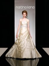288 Silk A-line wedding dress has a ruched bodice, soft fabric pickups on the skirt, and detachable spaghetti straps and belt with crystal beading. Lace up or zipper back available.