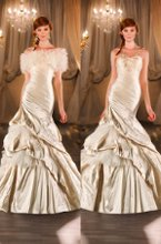 403 Silk fit-and-flare designer wedding gown features a tightly ruched bodice, dropped waist and accents of fabric souffles and tulle on the skirt. Jacket sold separately.