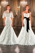 404 Designer A-line bridal gown has exquisite vintage-inspired re-embroidered, textural cotton lace detail, scalloped hem, and a traditional chapel train. Sash and capelet sold separately.