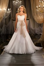 411 Silk Organza A-line designer wedding gown has a Swarovski Crystal beaded lace bodice featuriing re-embroidered silk ribbon, soft silk organza skirt and a flowing chapel train. Grosgrain ribbon sash sold separately.