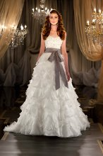418 Designer bridal ball gown features an encrusted Swarovski Crystal beaded bodice with sweetheart neckline, and a full skirt with billowing tiers of Silk Organza. Grosgrain ribbon sash sold separately.
