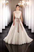 437 (shown with jacket) Silk Organza wedding ball gown features a detachable lace jacket with keyhole back and a scalloped lace hem. Lace up or zip up under covered buttons. Grosgrain ribbon included.