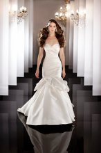 444 This fit-and-flare designer bridal gown features an asymmetrically ruched bodice and dropped waist finishing with a dramatic flared skirt. Lace up or zip up back. Venice lace jacket sold separately. Grosgrain ribbon sash sold separately.