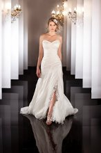 451 (shown with slit, without strap) Silk Organza A-line wedding gown with Swarovski Crystal beaded lace appliqués on the ruched bodice, and lace detailing on the detachable skirt insert and shoulder strap. Lace up or zip up.