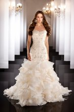 470 Designer tulle and organza wedding gown with hand tailored organza ribbon flower details placed throughout the dramatic elongated bodice with Swarovski crystals and diamantes.  Skirt features fabulous fabric folds from knee to hem.  Available in lace up or zip up back.