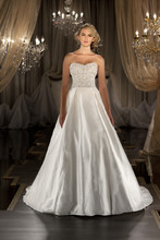 428 Silk designer A-line bridal gown features a Swarovski crystal and diamante encrusted sweetheart bodice and full skirt. Removable beaded tulle jacket and grosgrain ribbon sash sold separately.