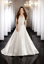 458 Strapless A-line designer wedding gown features an encrusted Swarovski Crystal and freshwater pearl bodice, full skirt and traditional chapel train. Lace up or zip up under covered buttons.