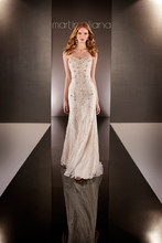 Martina Liana - 588  Less is elegantly so much more with this heirloom-quality hand-beaded Tulle over Parisian Silk Chiffon slim A-line gown from the Martina Liana designer bridal gown collection. It features bold Diamante accents along its sophisticated sweetheart neckline, figure-flattering fitted bodice and sweep train. The back closes with a concealed zipper.
