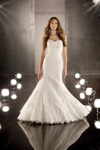 346 This timeless Designer fit-and-flare wedding gown features a sweetheart neckline with vintage embroidered Alencon lace over Silk Satin Organza. Chapel train has scalloped lace edging. Lace up or zipper back available.