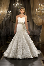 429 Designer fit-and-flare wedding gown features an asymmetrical ruched bodice with a sweetheart neckline, dropped waist, and a dramatically pleated full skirt. Lace up or zip up back available.