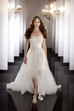 445 Cocktail-length designer bridal gown with Swarovski Crystal lace detailing comes with a detachable flowing tulle over-skirt and grosgrain ribbon waist sash.