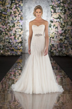 541 This modified fit-and-flair vintage lace wedding dress from the Martina Liana collection features heirloom quality Chantilly Lace and Tulle that transforms seamlessly into a flowing Silk Chiffon skirt. A back zipper hidden under lace buttons adds timeless appeal, and delicate details give this vintage lace wedding dress a romantic flair. Make this designer gown your own with the chic, hand-beaded crystal Tori sash in natural, topaz, bisque, blossom or orchid.