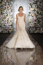 544 Every cut, every embellishment, every consideration of this Martina Liana dropped waist wedding dress is made with couture craftsmanship to create an enduring memory that will be celebrated for generations to come. Heirloom quality hand beading on Lace and rich Dolce Satin transform seamlessly into a full Tulle skirt and court train. Striking geometric cutout back, Diamante details throughout the bodice, and a back zipper hidden under fabric buttons add to this dropped waist wedding dress' unique and timeless appeal.