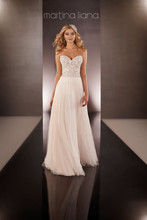Style 646  Parisian Silk Chiffon sheath dress from the Martina Liana wedding gown collection features hand-sewn Diamante beading on the sweetheart bodice, and an airy Tulle skirt and sweep train. The back zips up under crystal buttons.