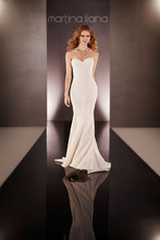 Style 647  Modern modified fit-and-flare bridal gown from the Martina Liana wedding gown collection is made from smooth, body-hugging Silk Moroccan fabrication and features a strapless sweetheart bodice and court train. The back zips up under fabric-covered buttons. This gown's clean, architectural look highlights the luxury of the fabric while making you the focus.