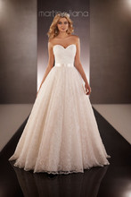 Style 649  Royal Organza designer ball gown from the Martina Liana wedding gown collection features a fitted sweetheart bodice and full skirt embellished with Lacey floral accents. Detachable 1.5