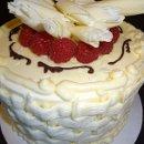 130x130 sq 1357603522208 whitecakewithraspberryfillingfromstackbistropastryandcake