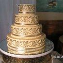 130x130 sq 1357603920014 goldtieredcake