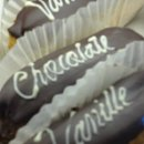 130x130 sq 1357604099412 chocolateandvanillaeclairsfromstackbistropastryandcake