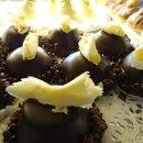 130x130 sq 1357604124390 chocolateigloosinshowcasebystackbistropastrycake