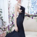 NZ3433  <br /> Black charmeuse trumpet gown, V-neckline, floral organza embroidery detail cascading down the sides and deep scoop back, sweep train