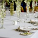 130x130 sq 1330108368604 closeupofwhiteweddingsetupandheadtable