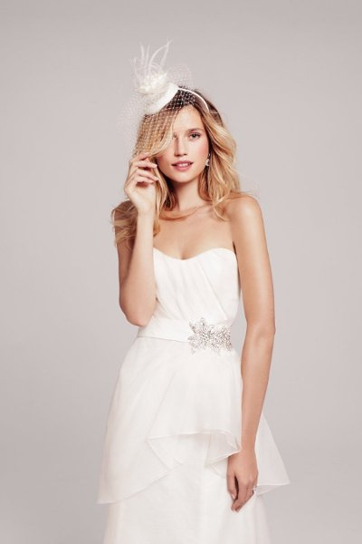 Nouvelle Amsale - #R103G  Created in silk organza, this trumpet-shaped gown has a ruched sweetheart neckline, seams through the skirt to create shape, a bow-knot sash and a train that's just the right size.