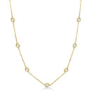 Diamond Station Necklace Bezel set in 14k gold, 7 round 0.15ct to 4.00ct diamonds wrap halfway around this aristocratic station style necklace.