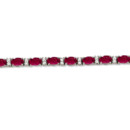 Diamond & Oval Cut Ruby Tennis Bracelet 24 oval rubies are accented by 50 brilliant cut round diamonds in this designer tennis bracelet. Custom gems available.