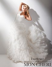 Style No. T211275 One-shoulder organza and taffeta ball gown with single crystal pleated organza ruffled strap, sweetheart bodice with directional pleating and dropped waistline, back bodice features full lace-up corset, dramatic multi-tiered crystal pleated organza ruffled skirt with taffeta trim, chapel length train.