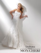 Style No. T211276 Strapless tulle and lace mermaid gown with softly curved neckline, hand-beaded lace dropped waist bodice with Swarovski crystals features a finely pleated tulle midriff decorated with Swarovski jeweled pendant, full lace-up corset back, hand-beaded lace skirt adorned with feathers trailing onto chapel length train. Detachable spaghetti and halter straps included.