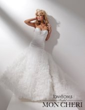 Style No. T211277 Strapless satin and organza ball gown, sweetheart neckline trimmed with hand-beaded jewels, directionally ruched bodice with dropped waistline, full ruffled organza skirt with chapel length train. Detachable spaghetti and halter straps included.