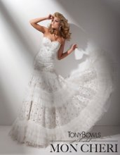 Style No. T211278 Strapless tulle and lace A-line gown with sweetheart neckline, jeweled and ornately hand-beaded bodice adorned with Swarovski crystals, dramatic dropped waistline, multi-tiered skirt features alternating layers of finely pleated ruffles and hand-beaded lace motif with Swarovski crystals, chapel length train. Detachable spaghetti and halter straps included.