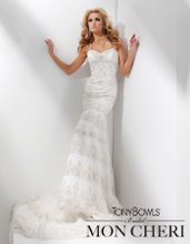 Style No. T211280 Sleeveless tulle and lace modified mermaid gown with hand-beaded spaghetti straps, softly pleated bust line, sweetheart bodice adorned with hand-beaded lace appliqué and Swarovski crystals, dramatic dropped waistline, multi-tiered skirt with scalloped beaded lace appliqués, chapel length train.