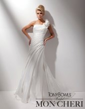 Style No. T211285 One-shoulder luxurious satin slim A-line gown, single strap ornamented with dramatic handmade three-dimensional flowers with hand-beaded crystal centers, softly pleated bodice with asymmetrically dropped waistline, softly side draped skirt with chapel length train. Matching shawl included (not shown).