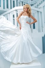 Style No. T112241 Strapless soft satin soft A-line gown, softly curved neckline and directionally pleated bodice trimmed with intricate hand-beading, curved back bodice embellished with covered buttons and beaded motif, dramatic asymmetrically dropped waistline, gathered skirt with chapel length train. Detachable spaghetti and halter straps included.