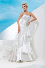 Style No. T112242 Strapless crystal organza A-line gown with softly curved neckline, side draped bodice trimmed with elaborate Swarovski crystal jeweled hand-beading, covered buttons cascade down back bodice to beaded jeweled motif, asymmetrically dropped waistline, side draped three-tiered skirt with chapel length train. Detachable spaghetti and halter straps included.