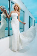Style No. T112247 Strapless Venise lace over sequined satin modified mermaid gown with hand-beaded detachable belt at natural waistline, low dipped back bodice, chapel length train. Detachable spaghetti and halter straps included.