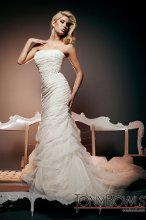 T212270 Strapless draped and gathered tulle over metallic lace modified mermaid gown, intricately hand-beaded jeweled midriff, dropped waistline, soft pick-up skirt with bubble hemline and chapel length train. Detachable spaghetti and halter straps included.