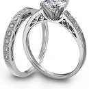 <b>Simon G. Jewelry platinum engagement ring and wedding band</b> <br />Simon G. Jewlery platinum and diamond engagement ring with a matching wedding band.
