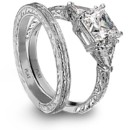 <b>Jamesallen.com platinum engagement ring and wedding band</b> <br />Platinum 3-stone diamond engagement ring and matching wedding band features an engraved shank with trillion cut diamonds by JamesAllen.com.