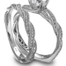 <b>Simon G. Jewelry platinum engagement ring and wedding band</b> <br />Simon G. Jewelry platinum and diamond engagement ring with a matching wedding band.