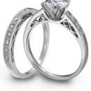 Simon G. Jewelry platinum engagement ring and wedding bandSimon G. Jewlery platinum and diamond engagement ring with a matching wedding band.