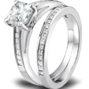 The timeless charm of channel set, carré cut diamonds. And this glamorous Jeff Cooper Designs engagement ring's delicate design lets your center stone be the center of attention. Lines up beautifully with matching Wedding Band (R-3109/B). This Wedding Band is also available in an eternity versions. Can be custom made to fit any shape center stone. Hand crafted in Platinum.